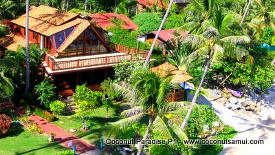 Spacious holiday home with balcony, veranda and beachfront sala.