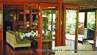 All glass veranda doors encircle the living room.